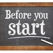 Before your start sign - white chalk text on a vintage slate blackboard