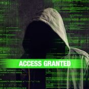 Access granted to Faceless hooded anonymous computer hacker with programming code from monitor