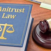 Antitrust law book and gavel