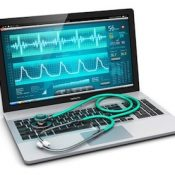 Laptop with cardiologic diagnostic test software on screen and stethoscope