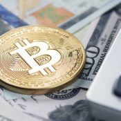 Cryptocurrency - https://depositphotos.com/136583164/stock-photo-bitcoin-with-us-dollars-and.html