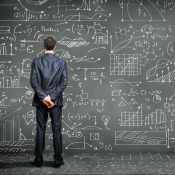 https://depositphotos.com/13469724/stock-photo-business-person-against-the-blackboard.html