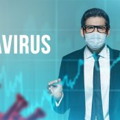 Portrait of a businessman in medical mask behind holographic charts with bacteria and the words Coronavirus. Business concept. Pandemic.